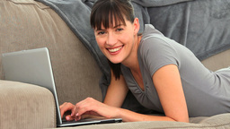 Cute brunette chatting with a laptop Stock Video Footage