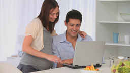 Future parents using a laptop Stock Video Footage