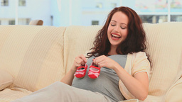 Brunette playing with shoes Stock Video Footage