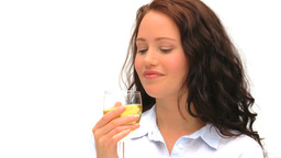 Good looking lady enjoying a glass of wine Stock Video Footage