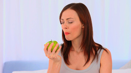 Relaxed woman eating an apple Footage