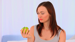 Relaxed woman eating an apple Stock Video Footage