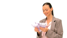 Happy businesswoman holding her cash Stock Video Footage