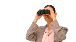 Woman looking through binoculars against a white b Footage