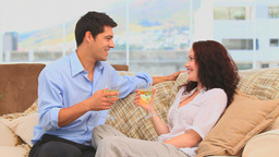 Couple drinking wine in the living room Stock Video Footage