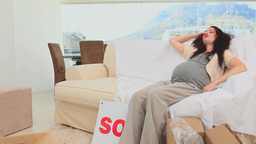 Man with his pregnant woman in their new home Stock Video Footage