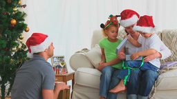 Boy offering his present on Christmas day Footage