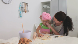 Mother baking with her daughter Stock Video Footage