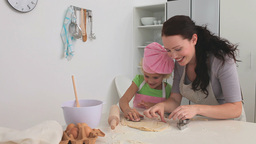 Mother baking with her daughter Footage