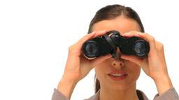 Lovely woman looking through binoculars Footage