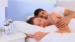 Lovely couple waking up in their bed Stock Video Footage