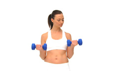 Attractive brunette with dumbbells Stock Video Footage