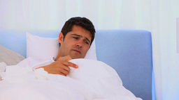 Woman taking care of her sick husband Stock Video Footage