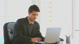 Businessman working in his office Stock Video Footage