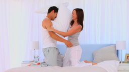 Happy couple having a pillow fight Footage