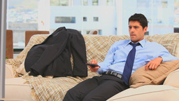 Businessman watching tv in the living room Footage