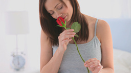 Beautiful woman with her rose Stock Video Footage