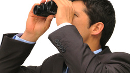 Businessman looking through binoculars Footage