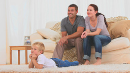 Family watching the tv together Stock Video Footage