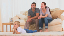 Family watching the tv together Footage