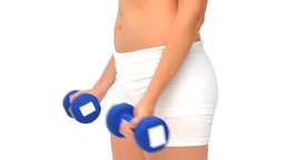 Woman using dumbbells Stock Video Footage