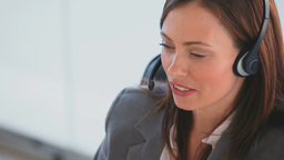 Business woman speaking over the headset Stock Video Footage