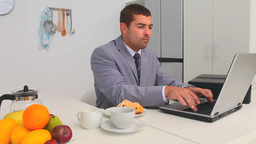 Businessman working during his breakfast Stock Video Footage