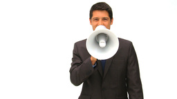 Businessman speaking through a megaphone Footage