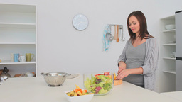 Pregnant woman preparing a salad Stock Video Footage