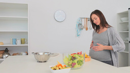 Pregnant woman preparing a salad Footage