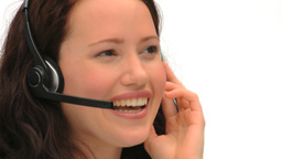 Brunette woman speaking over the headset Stock Video Footage