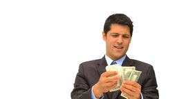 Businessman showing off his cash Stock Video Footage