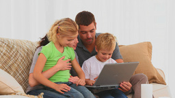 A family using a laptop Footage