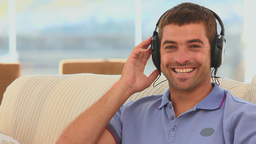 Casual man listening to music Stock Video Footage