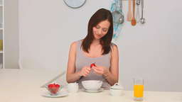 Cute brunette cooking with strawberries Stock Video Footage