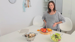 Pregnant female cooking Footage