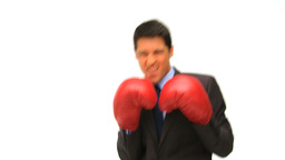 Man dressing in a business suit with boxing gloves Footage
