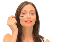 Coquette brunette putting on makeup Footage