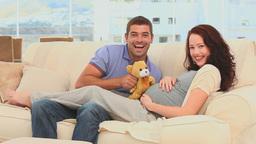Cute couple holding a teddy bear Stock Video Footage