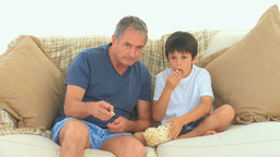 A grandfather with his grandson watching tv Stock Video Footage