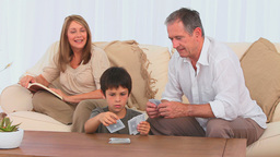 Family playing cards together Stock Video Footage