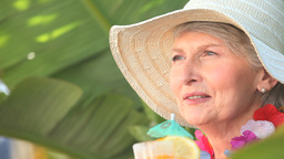 Mature woman with an hat holding a cocktail Stock Video Footage
