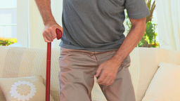 Retired man using a walking stick Footage