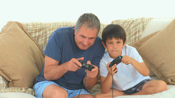 A child playing video games with his grandfather Footage