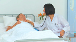 Nurse using a stethoscope Footage