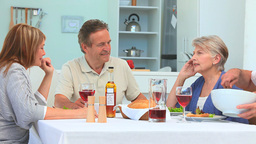 Senior friends eating together Stock Video Footage