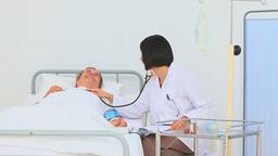 A nurse using a stethoscope Footage