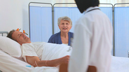 A patient having a visit of his nurse Stock Video Footage