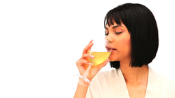Attractive asian woman drinking a glass of white w Footage