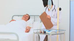 An asian nurse visiting a patient Footage
